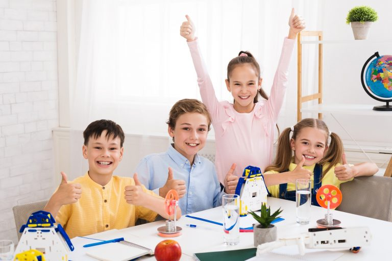 Stem education. Happy children showing thumbs up